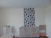 Wandflächen mit Tapeten abgesetzt